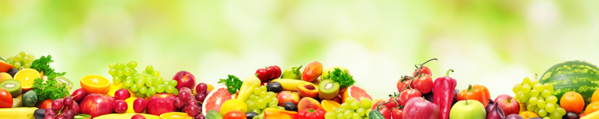 Panoramic collection fresh fruits and vegetables for skinali on blur green background.
