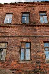 Facade of old red brick building in Vyborg, Russia