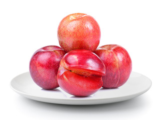 plum in a plate isolated on a white background