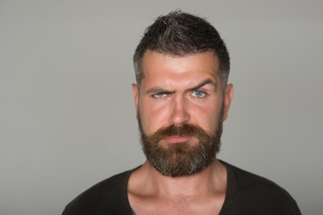 Hipster man with frown face, beard, mustache, hair
