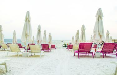 The sun beds on a beach near summer mediterranean resort in  Turkey.