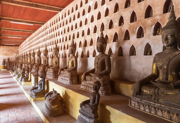 rows of public ancient buddha statue in wat Si Saket temple Vientiane capital city, Laos
