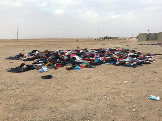 Clothing donated by locals for displaced families is seen in the middle of the remote village of Zinana