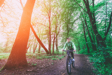 MTB Cyclist in the forest sunlight