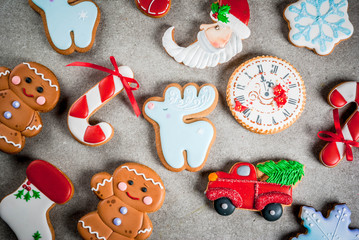 Christmas background wit selection of homemade colorful gingerbread cookies. Top view, copy space