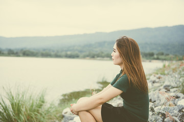 portrait of aisan woman feeling sad outdoor,heartbreak girl concept.