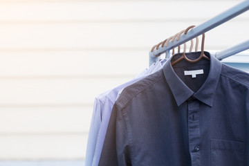Housework of dry cleaning clothes man shirt