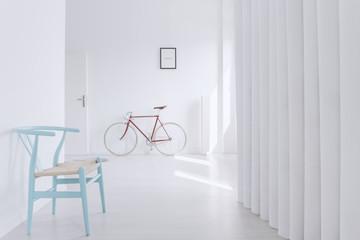 Blue designer chair in corridor