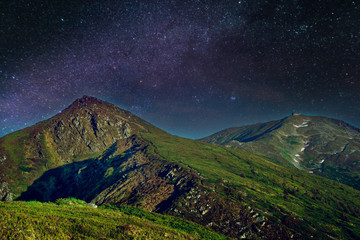 Night starry sky in the mountains,old observatory in the Carpathian Mountains, Night landscape with colorful Milky Way