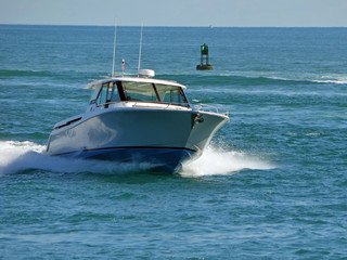 Fishing boat returning to port entering Government Cut in Miami