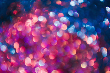 New year festive background. Defocused bokeh blur flares. Colorful abstract twinkle lights concept