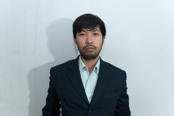Portrait of asian handsome man messy wear suit on white backgrond
