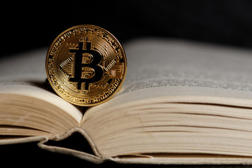 Gold bitcoin - popular cryptocurrency on open book page