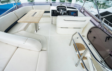 Interior of luxury modern yacht with driving place.