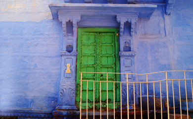 Blue city, Jodhpur, Rajasthan, India. Blue houses, background. Bright blue streets and walls. Popular tourist city in India. Old vintage wood carved door. Indian style.