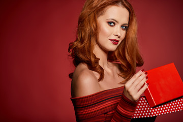 amazing redhead woman with christmas gift box