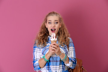 Attractive hipster girl posing with ice cream on color background
