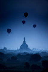 Fotobehang Zonsondergang Sunrise scene hot air balloons fly over pagoda ancient city field in Bagan Myanmar. (High image quality)