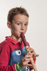 child plays flute