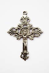 silver cross with a jesus on white background