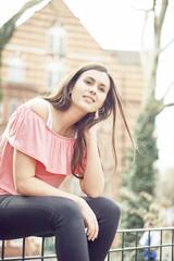 Teenage girl sitting in park