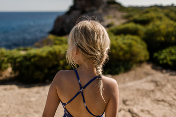 Girl exploring hills at Calo des Moro in Mallorca