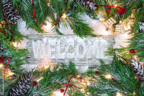 Welcome Sign With Christmas Tree Garland Border String Of Holiday Lights Pine Cones And