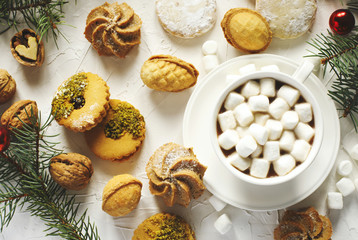 Cup of ho chocolate and assorted cookies: linzer cookies,shortbread, nuts cookie, orange almond cookie.