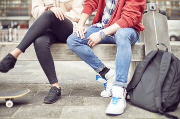 Legs of teenage couple sitting together