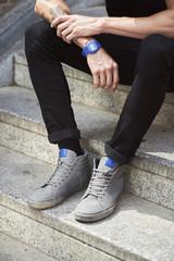 Legs of teenage boy sitting on staircase