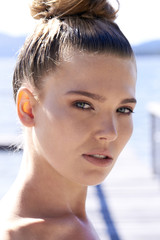 Portrait of young woman with hair bun