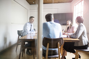 Businesspeople at meeting in office conference room