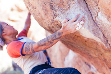 Closeup of hand of young asian woman rock climbing in the desert Wall mural