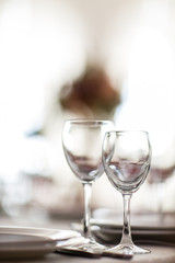 Photo of two wineglasses on blurred background