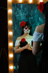 Photo of zombie woman with white face with red flower on her head