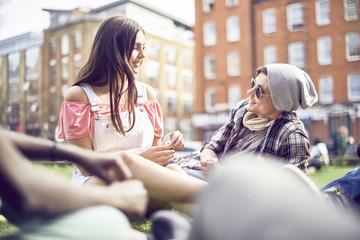 Teenage couple sitting at park