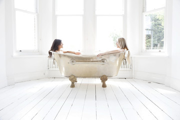 Young women in bath tub