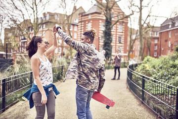 Teenage couple dancing in park