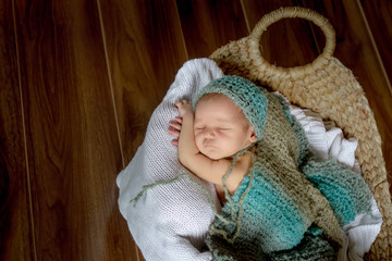 indoor portrait of newborn baby wrapped, newborn photography