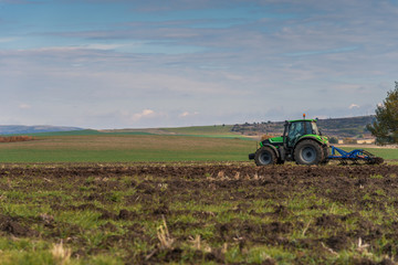 Tractor plowing fields.