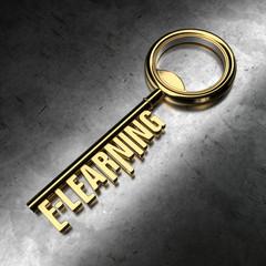 E-Learning - Golden Key on Black Metallic Background.