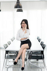 Secretary beautiful girl on the desk in the office of the company.