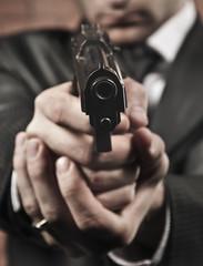 pistol in the hands of the gun barrel
