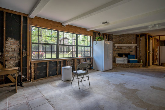 Bare walls of a flooded home after drywall and floors have been removed