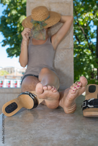Beauty Girl In Bare Feet With Dirty Soles
