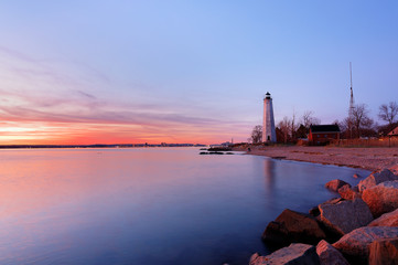 New Haven Light House at Lighthouse Point Park At Sunset. The lighthouse is dark, but the tower remains, greeting ships from around the world to New Haven, Connecticut, USA.