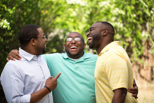 Brothers laughing and talking.
