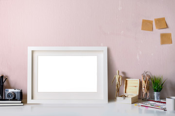 Mockup : Workspace poster or photo frame and supplies on table hipster minimalism loft desk space, copy space