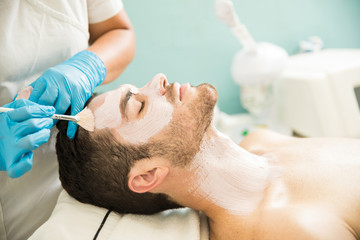 Man getting a facial treatment