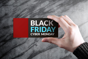 Black Friday and Cyber Monday Promotional Concept, Woman holding a Discount Coupon with Blank Space for Text